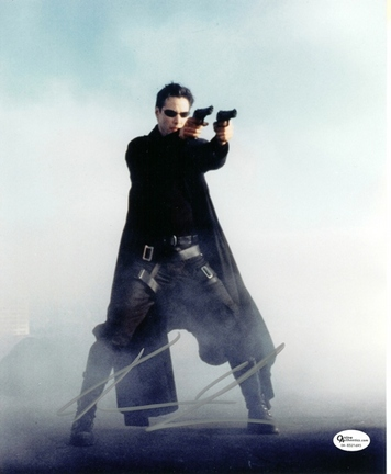 "Keanu Reeves ""Matrix"" with Guns Autographed 8"" x 10"" Photograph (Unframed)"
