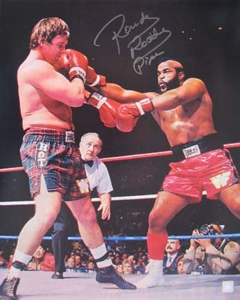 "Rowdy Roddy Piper Autographed ""Boxing Mr. T."" 16"" x 20"" Photograph (Unframed)"