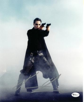 "Keanu Reeves ""Matrix"" with Guns Autographed 8"" x 10"" Photograph (Unframed)"